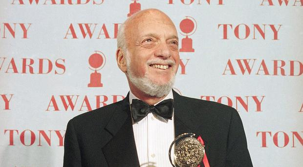 Harold Prince holds his 1995 Tony award for best director in a musical for Show Boat (Richard Drew/AP)