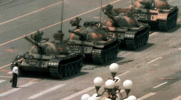 A man stands in front of a column of tanks during protests at Tiananmen Square in 1989