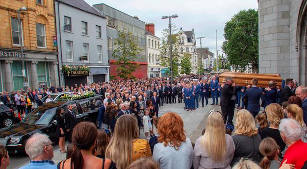 The large crowd at St Patrick and St Colman's Cathedral for the funeral of Brian Conlon yesterday