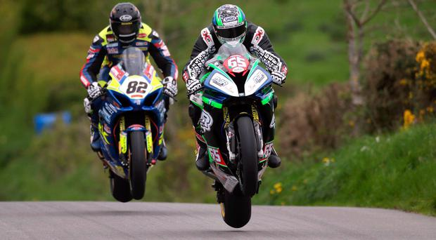 Close encounter: Derek Sheils and Michael Sweeney will renew their rivalry at the Ulster Grand Prix at Dundrod this month