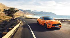 The new Mustang55 Edition features unique exterior styling including distinctive bonnet and side-stripes, badging, and optional rear spoiler, alongside a new higher-spec interior