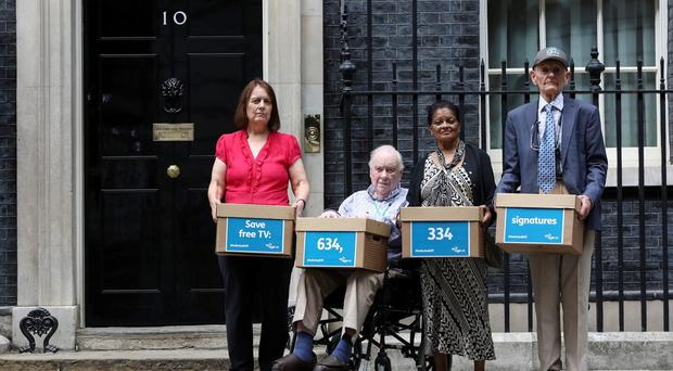 Pensioners outside Number 10 Downing Street (Georgie Scott/Age UK/PA)