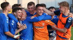 PressEye-Northern Ireland- 1st August 2019-Picture by Brian Little/PressEye Glasgow Rangers goal keeper Jack McConnell is mobbed after his save in a penalty shoot-out defeats Co Tyrone in the STATSports SuperCupNI Junior Semi Final , at Coleraine Showgrounds . Picture by Brian Little/PressEye