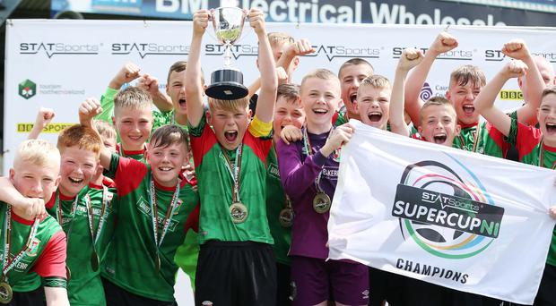 Glentoran captain Lucas Miskimmin lifts the SuperCupNI minor trophy.