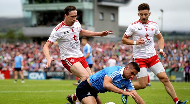 Big guns: Tyrone's Colm Cavanagh and Dublin's James McCarthy battle it out in the Super 8s in Omagh last summer