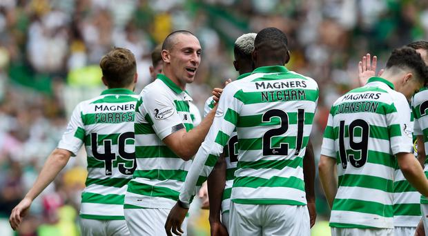 Celtics Scott Brown congratulates Celtics Olivier Ntcham after he scored during the Ladbrokes Scottish Premiership match at Celtic Park, Glasgow. Ian Rutherford/PA Wire.