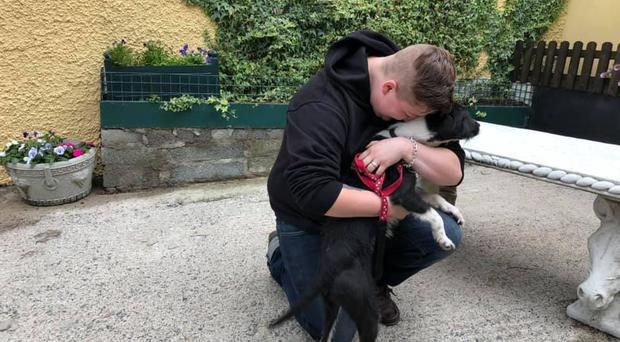 Dog owner reunited with Riley. Credit: Helen Marks