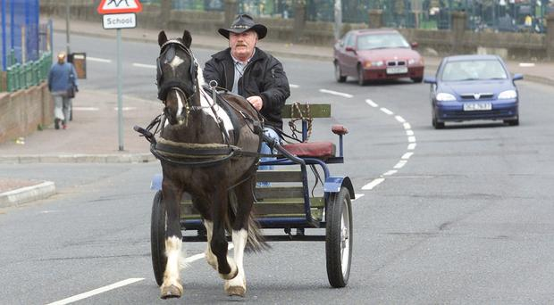 Seamus Conlon taking his four year old pony Murphy along the Whiterock Road. Picture taken in 2004.