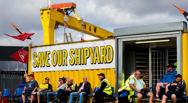 Employees of Harland and Wolff during their protest at the gates of the shipyard in Belfast.