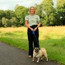 Glynis Stewart and Alfie her dog at the spot in Six Mile Water where she was attacked by wasps
