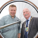 Big support: Stephen Laird of Chain Reaction Cycles (left) and councillor Charlie Casey
