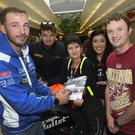 Signing on: Riders Paul Jordan, Conor Cummins and Patricia Fernandez meet race supporters Joe and Sophia Dempsey ahead of Ulster Grand Prix practice starting today at Dundrod