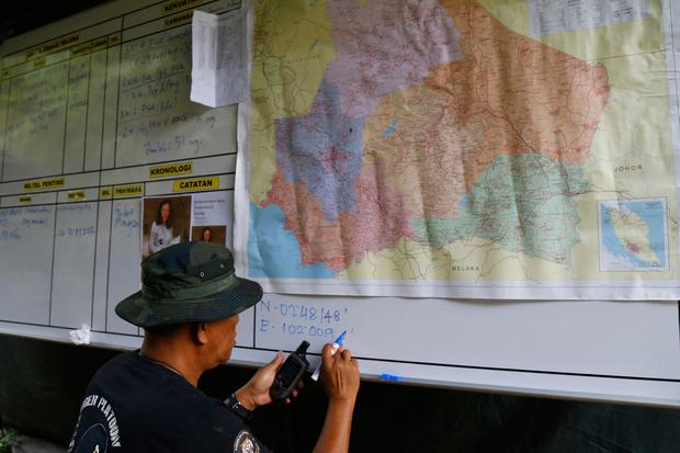 A member of General Operations Force works at a temporary operation shelter near The Dusun resort where a 15-year-old London girl went missing (AP Photo/Lai Seng Sin)