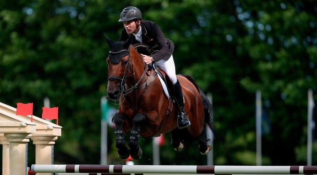 Up and over: Ireland's Mark McAuley on Utchen De Belheme in the Sport Ireland Classic International at Dublin Horse Show at RDS yesterday