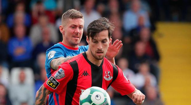 Rivals reunited: Declan Caddell takes on Linfield's Daniel Kearns last season