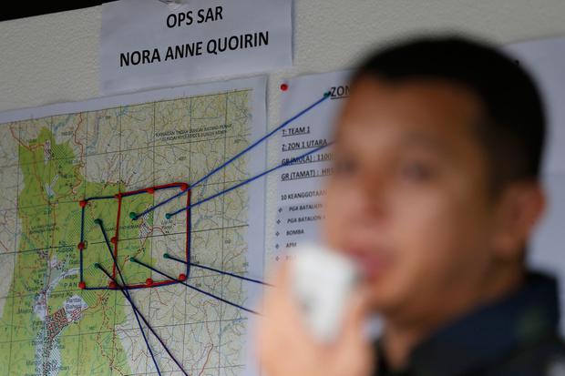 A map shows search and rescue zones for a missing British girl in Seremban, Negeri Sembilan, Malaysia, Thursday, Aug. 8, 2019. Malaysian police said Wednesday they were analyzing fingerprints found in a forest resort cottage where Nora Anne Quoirin, the British teenager missing in Malaysia, was reported missing and did not rule out a possible criminal element. (AP Photo/Lai Seng Sin)