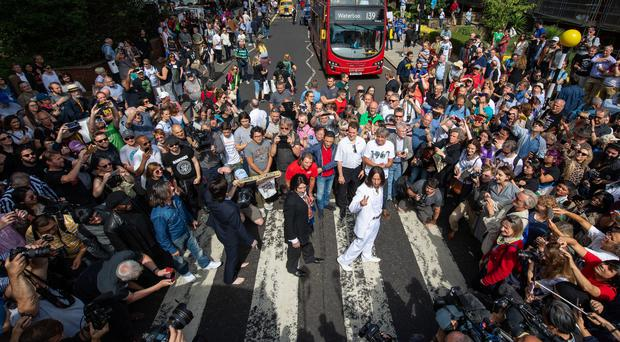 Hundreds of Beatles fans flock to Abbey Road on photo's 50th anniversary (Dominic Lipinski/PA)