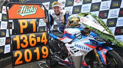 Peter Hickman celebrates after setting a new world record lap speed at 136.415mph on his way to winning the Thursday Superbike race at the 2019 fonaCAB Ulster Grand Prix.