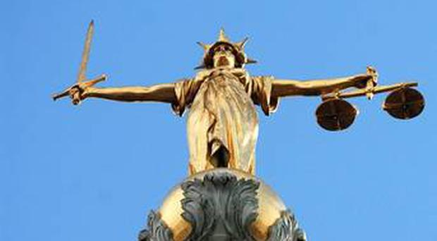 A judge moved his court to a car park yesterday to deal with a man accused of threatening to kill a female prison officer