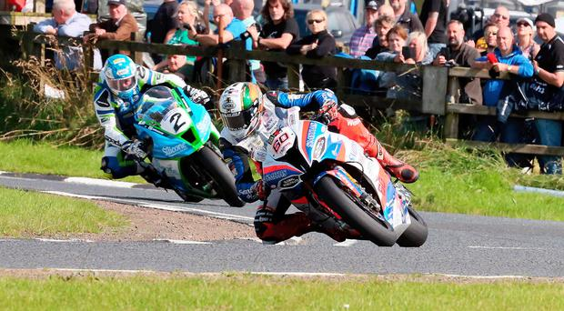Road warrior: Peter Hickman leads Dean Harrison in the Superbike race