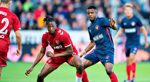 Close watch: Rangers' Joe Aribo and Frank Onyeka Ogochukwu of FC Midtjylland fight for the ball