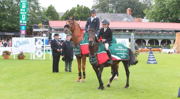 On high: winners of the International Pairs relay at the Stena Line Dublin Horse Show, Shane Breen on Golden Hawk and Portadown rider Peter Morton with Tynan Tuttle Pip