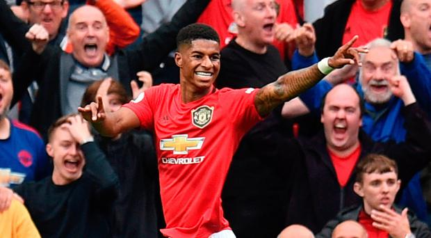 Marc of class: Marcus Rashford celebrates his second goal