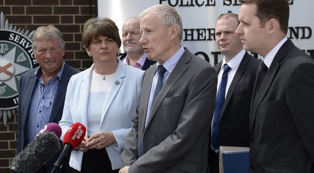 DUP Leader Arlene Foster and Gregory Campbell pictured at Police head quarters in Belfast after a meeting to discuss the policing decisions taken in Londonderry on Saturday at the annual Apprentice Boys parade. Credit : Stephen Hamilton/Presseye