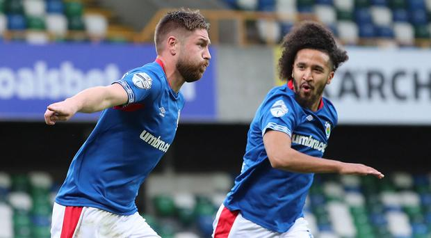 Mark Stafford celebrates his opening goal at Windsor Park on Tuesday evening.