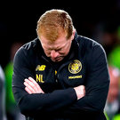 Down and out: Celtic manager Neil Lennon shows his dismay as his side crashed out of the Champions League last night