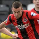 Man on: Crusaders winger Paul Heatley is closed down by Alan OSullivan at Seaview last night