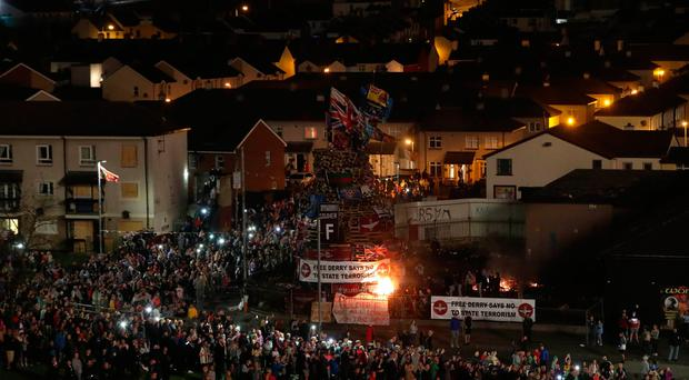 The main bonfire is lit in the Bogside area of Londonderry in Northern Ireland. Credit: Niall Carson/PA Wire