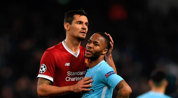 In air: Dejan Lovren may leave Liverpool after dropping down the pecking order