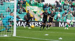 Celtic's James Forrest fires in the late, late winner against Dunfermline.