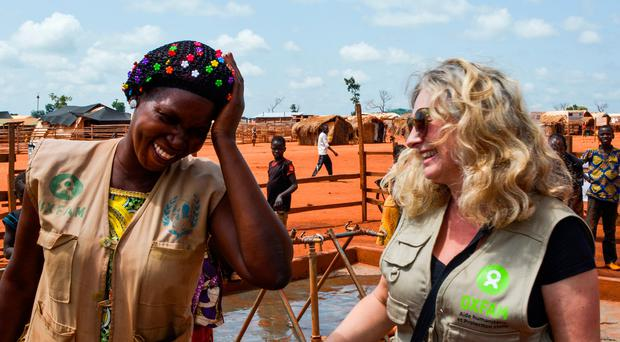 Fionna Smyth, 49, their head of humanitarian campaigns and advocacy policy, talking with water treatment worker Al Foncine. Credit: Oxfam/PA