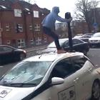 Gerard Donegan on the Falls road west Belfast attacking a bus lane camera car.