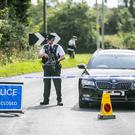 Armed PSNI officers at a Road Block at Gortinacarrow Co Fermanagh about two miles from the scene at Wattle Bridge.