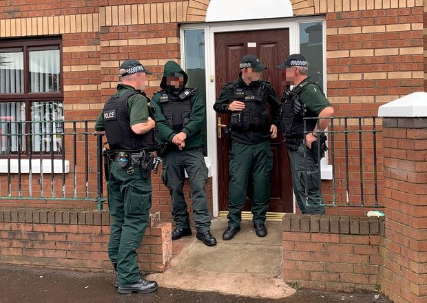 Police officers search the house of Alex Murphy in west Belfast following a social media video showing shots being fired over his coffin in the family home (Photo by Kevin Scott / Belfast Telegraph)