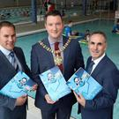 Gareth Kirk, Regional Director at GLL, Lord Mayor of Belfast, Councillor John Finucane and John McGuigan, Chair of Active Belfast Limited.