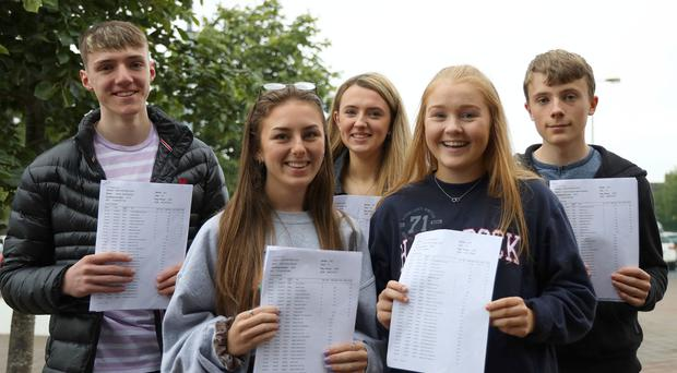 There has been a rise in the number of GCSE entries awarded A*-C grades in Northern Ireland. GCSE students Joseph McNaughton, Rhea Stewart,Victoria Lloyd, Alison Riley and James McAleese from Grosvenor Grammar School, Belfast, who received results today. Photo by Laura Davison, Pacemaker Press.