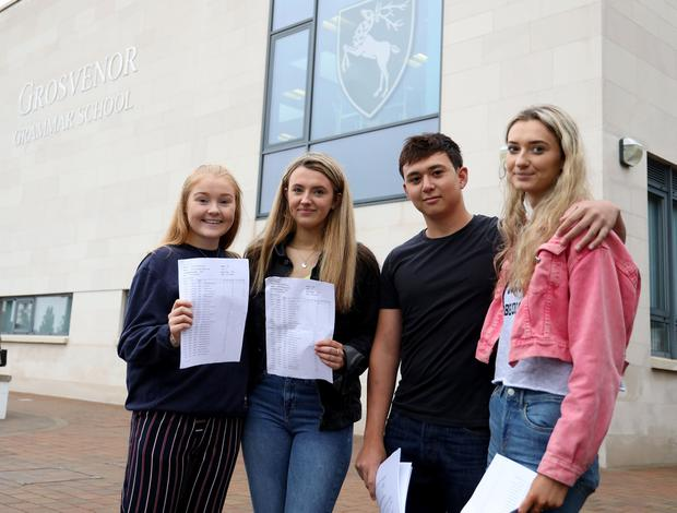 PACEMAKER PRESS BELFAST 22/8/2019 There has been a rise in the number of GCSE entries awarded A*-C grades in Northern Ireland. GCSE students Victoria Lloyd, Alison Riley, Nathan Moffett and Zoe Jess from Grosvenor Grammar School, Belfast, celebrating their results this morning. Photo by Laura Davison, Pacemaker Press.