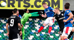 Head man: Shayne Lavery swoops to score Linfield's second goal last night