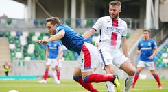 Windsor win: Stephen Lowry (right) battles with Linfield's Joel Cooper