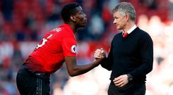 Main men: Manchester United manager Ole Gunnar Solskjaer (right) has backed the contribution of Paul Pogba (left)