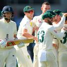 Got him: Australia celebrates as Joe Root trudges off
