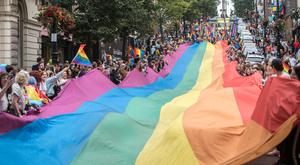 The Foyle Pride Festival Parade makes it's way down Shipquay Street in Derry on Saturday. Credit: Martin McKeown