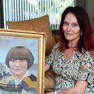 Mary Hornsey, with a painting of her 15-year-old son Paul Maxwell (Brian Lawless/PA)