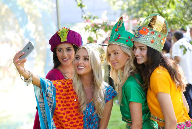 Meagan Green and friends at the opening procession takes place at the Belfast Mela. Credit: Kelvin Boyes/PressEye