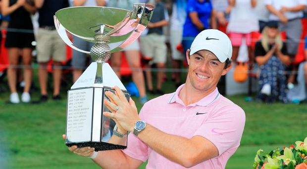 Rory McIlroy gets his hands on the FedEx Cup for the second time after success at the Tour Championship.