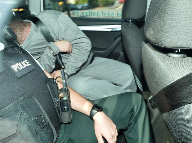 PACEMAKER BELFAST 26/08/2018 Jake O'Brien appears at Lisburn Court charged with the murder of Malcolm McKeown. The 54-year-old was found dead in his car behind a service station in Waringstown, County Down, on the 19th of August. The court was told that police believe his murder was part of a